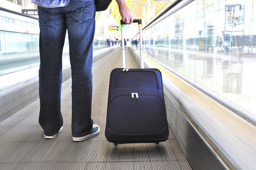 Suitcase at airport (stock)