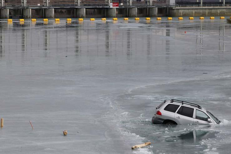 Car parked in frozen lake