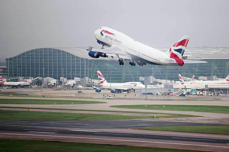 British Airways owner says profits hit by weak pound and strikes