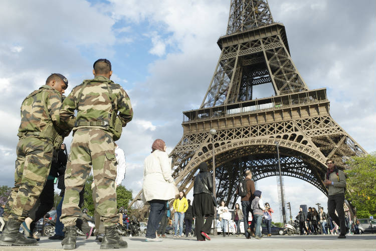French army soldiers patrol the Eiffel Tower in Paris, terrorism