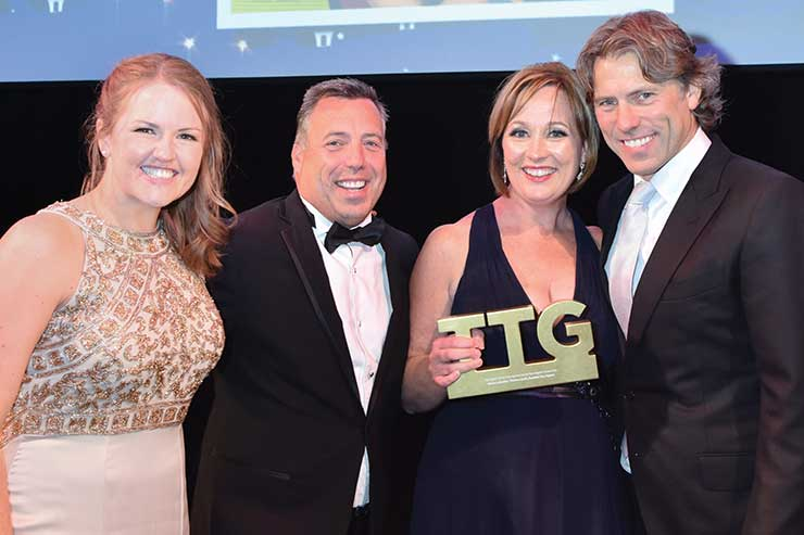 Moira Lumsden collecting a TTG Travel Awards gong