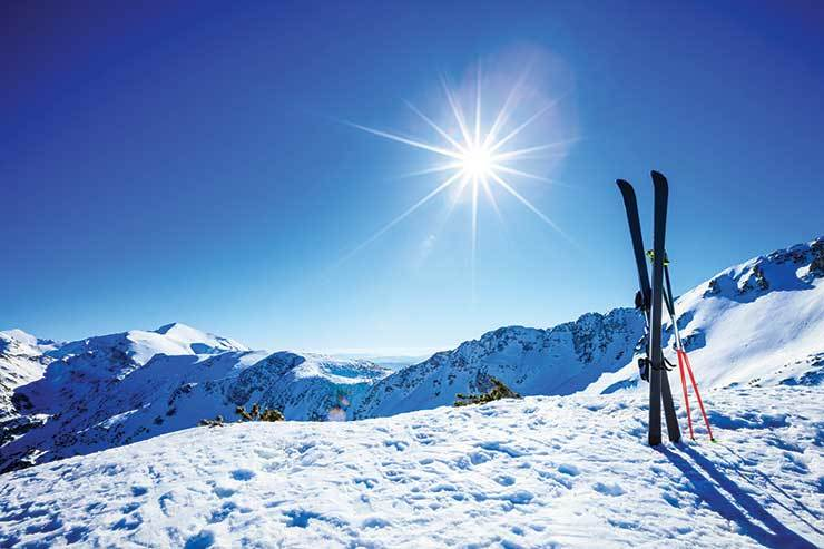 Skis in the snow iStock-499255084