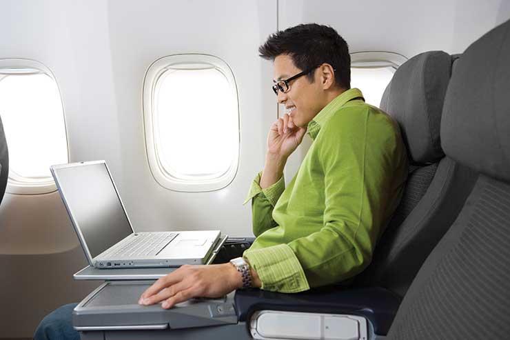 Laptop work on a flight iStock-172898489