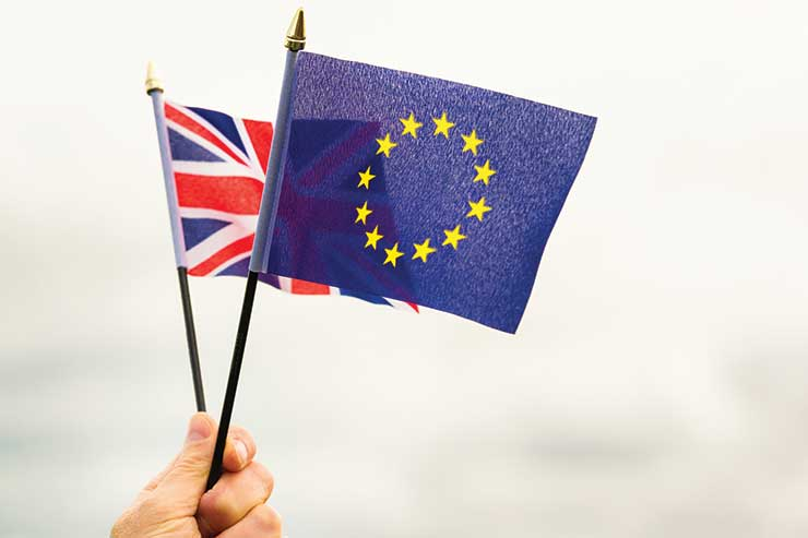 Brexit, Union Jack and EU flags iStock-534449694