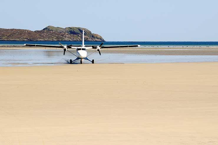 Light aircraft landing on beach iStock-174798675