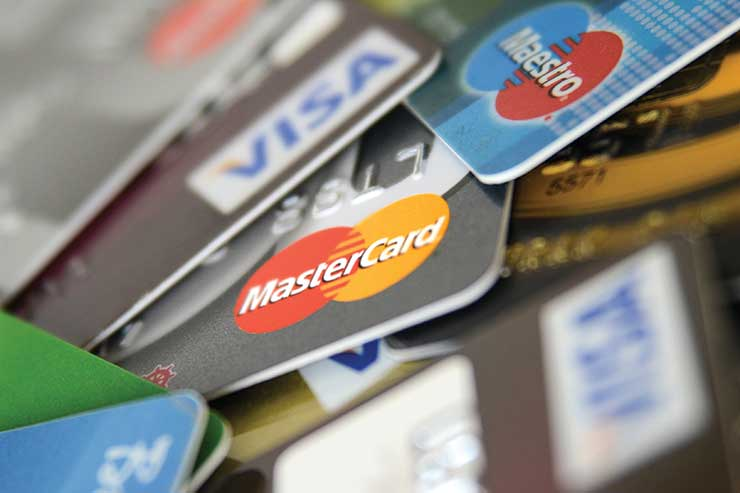 Agent urges industry pressure on card charge fees