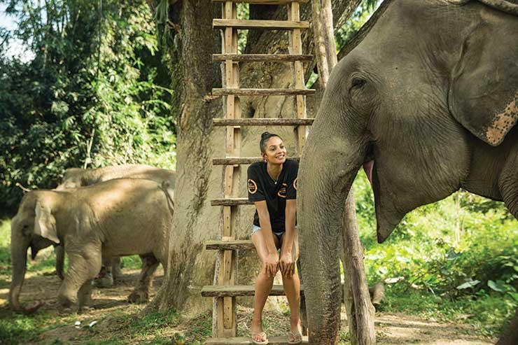 Alesha smiling with Lotus at Boon Lotts Elephant Sanctuary in Thailand