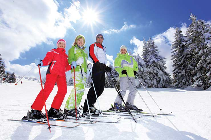 Skiing family on the piste