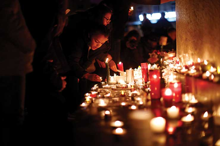 Mourners pay their respects. Photo Credit: Getty Images