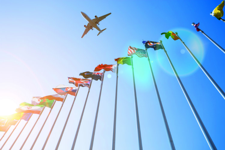 Aircraft over flags iStock-529401642.jpg
