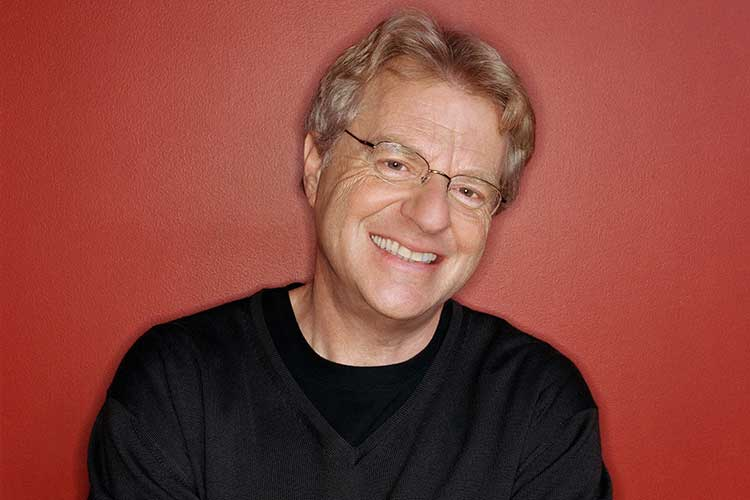 Jerry Springer in a black sweater