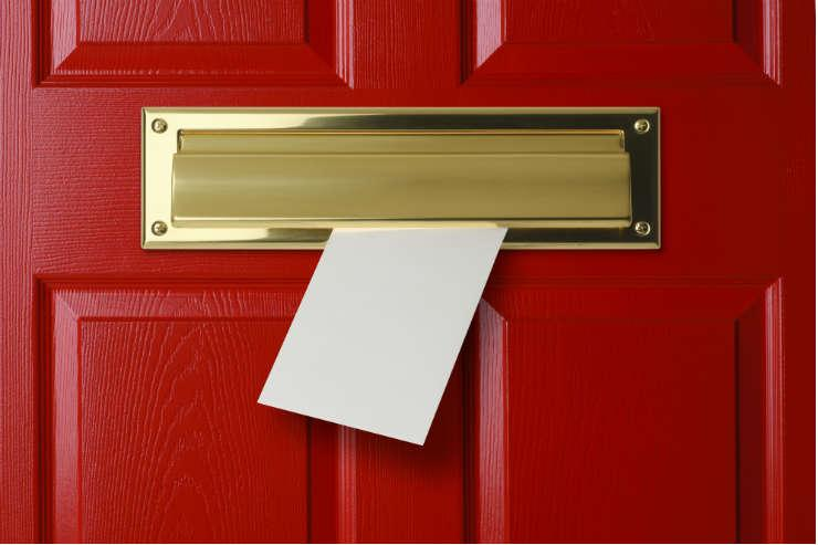Letter coming through a letter box