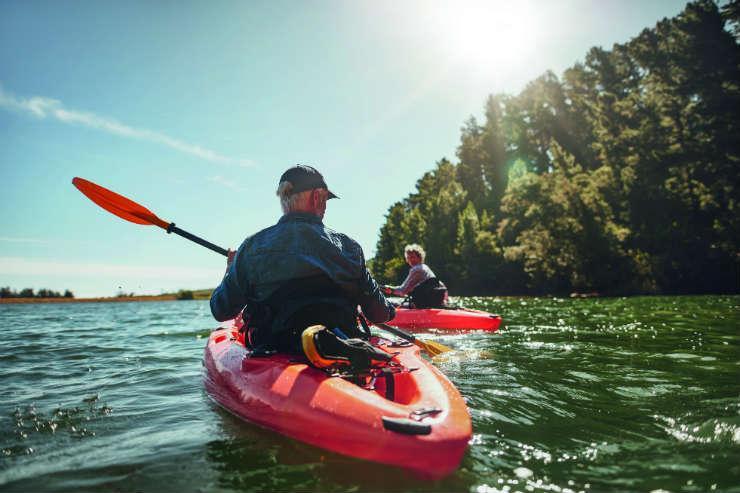 Mature couple kayaking