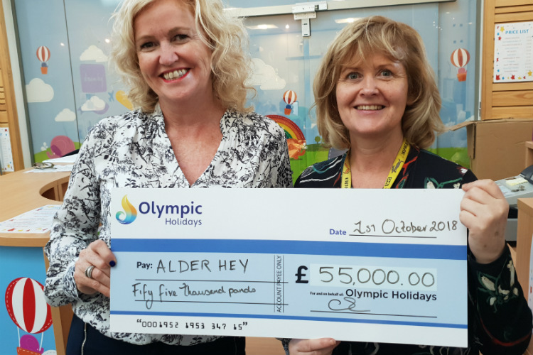 Olympic Holidays hands over £55,000 to Alder Hey Children's Charity