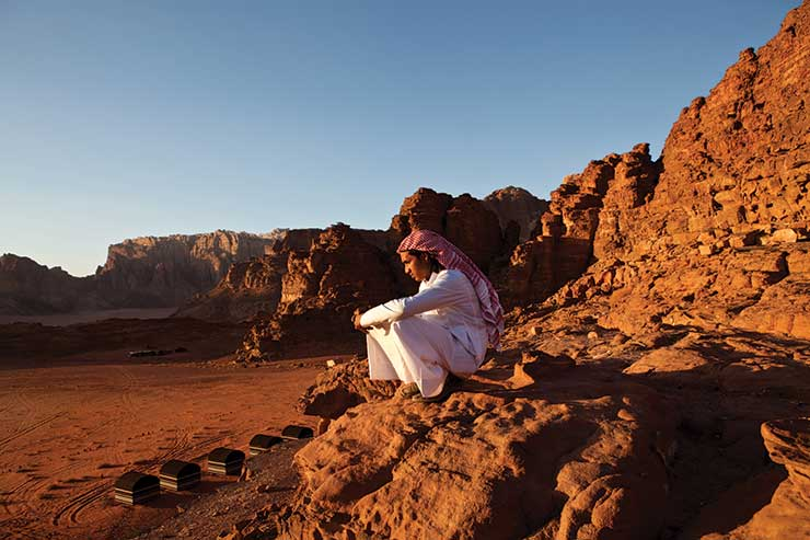Man sitting in rocks in Jordan