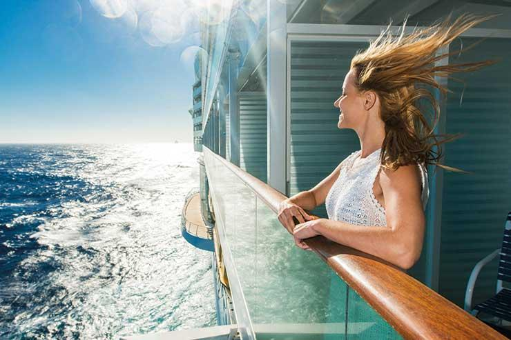 Lady on the deck of a cruise ship at sea