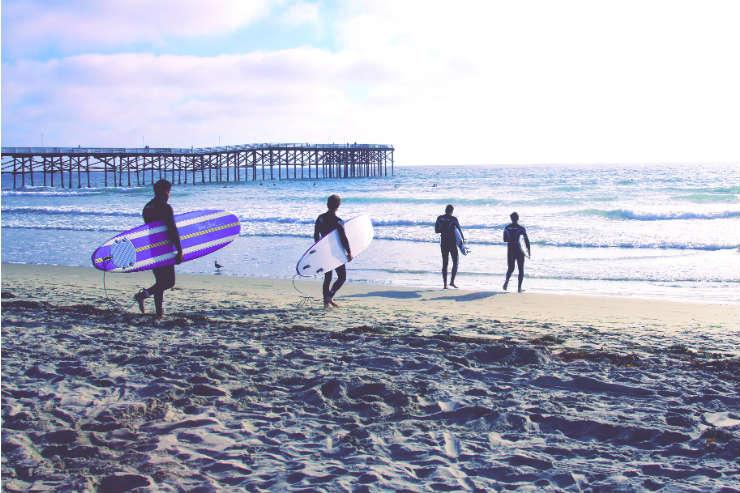 Surfers on Pacific Beach, California