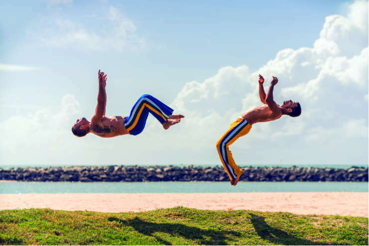 Two men practising capoeira