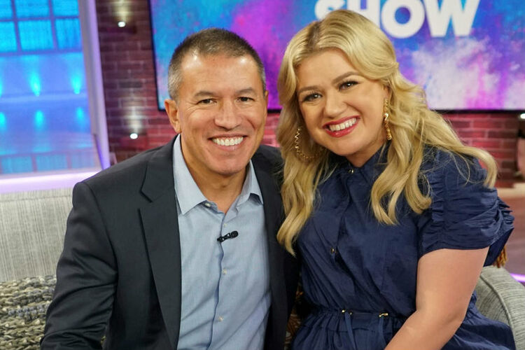 NCL boss Andy Stuart appeared on Kelly Clarkson's show to ask her to become godmother