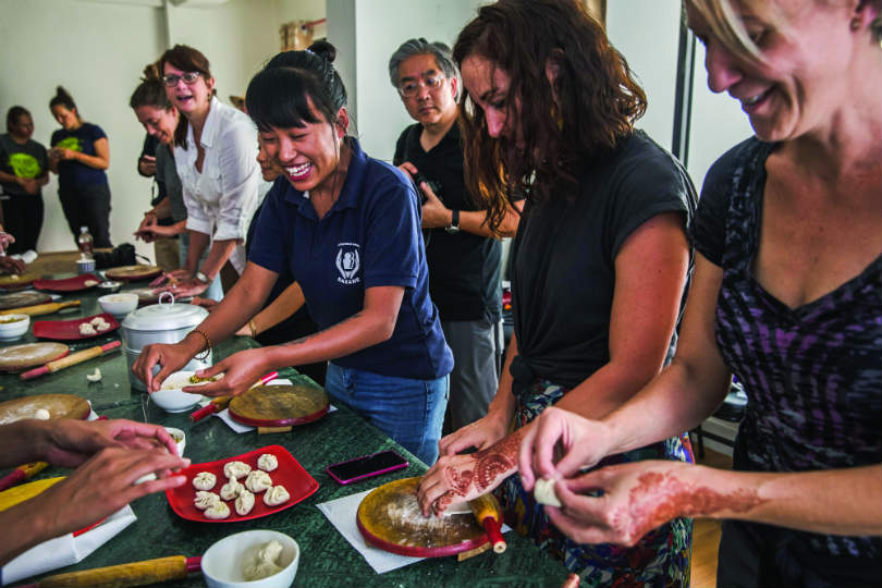G Adventures works with SASANE to offer clients local cooking classes in Nepal