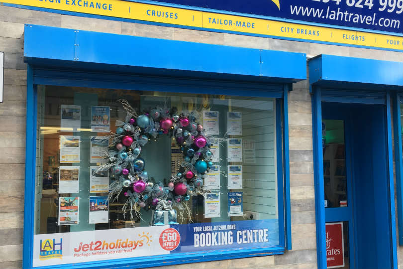 LAH Travel employ a window dresser, who always uses a gigantic 5-foot wreath