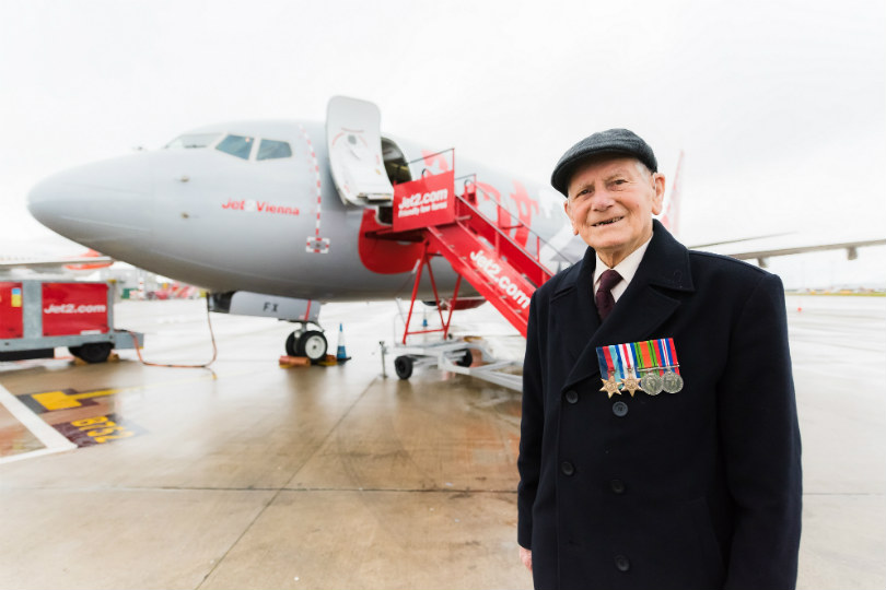 Eddie Morrison, a Second World War veteran, outside the Boeing 737-800 NG