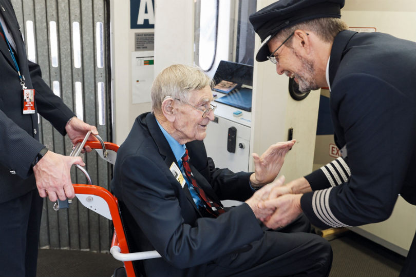 Veteran Frank Dell meeting a British Airways pilot