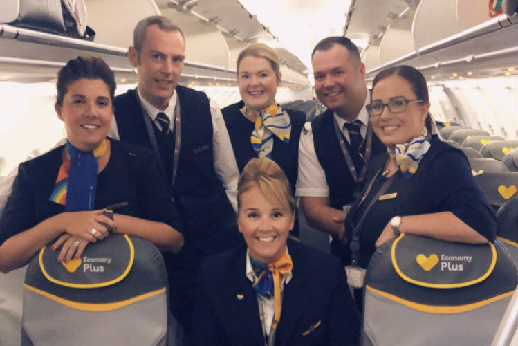 Carolyn Russell (back row, centre) worked as cabin crew for Thomas Cook Airlines for 16 years