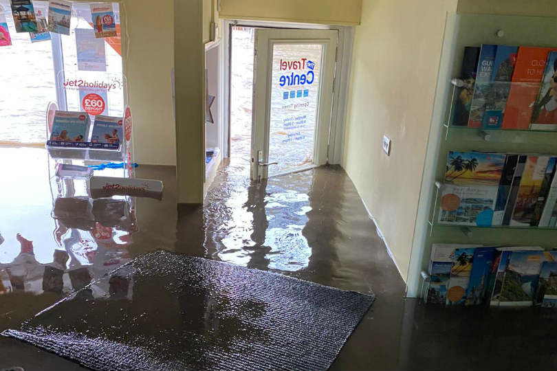 The Travel Centre's door was forced open during the flood