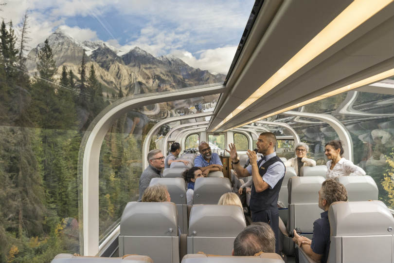 Rocky Mountaineer trains travel through majestic mountain scenery