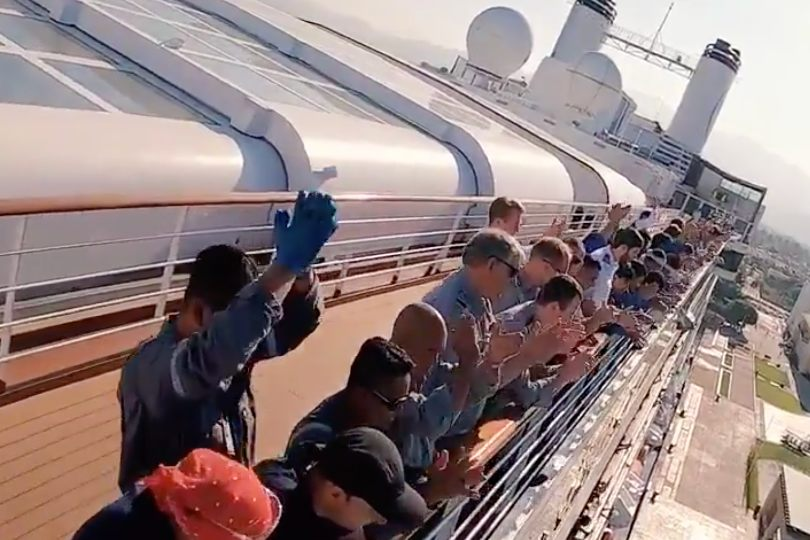 People applauding onboard the MS Rotterdam
