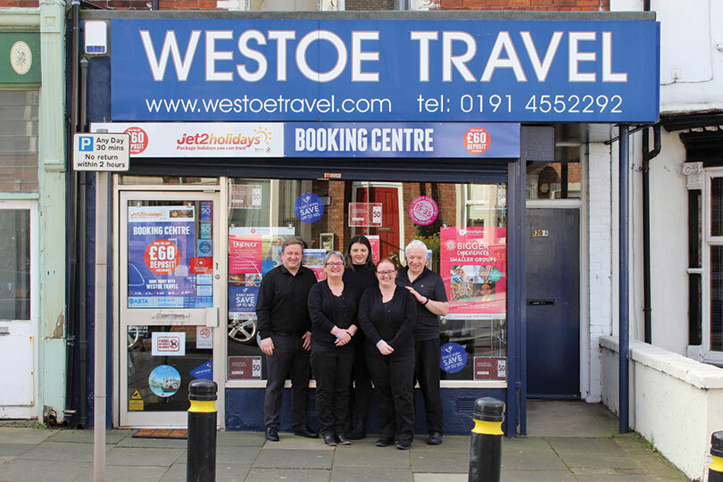 Graeme Brett, right, with staff at Westoe Travel