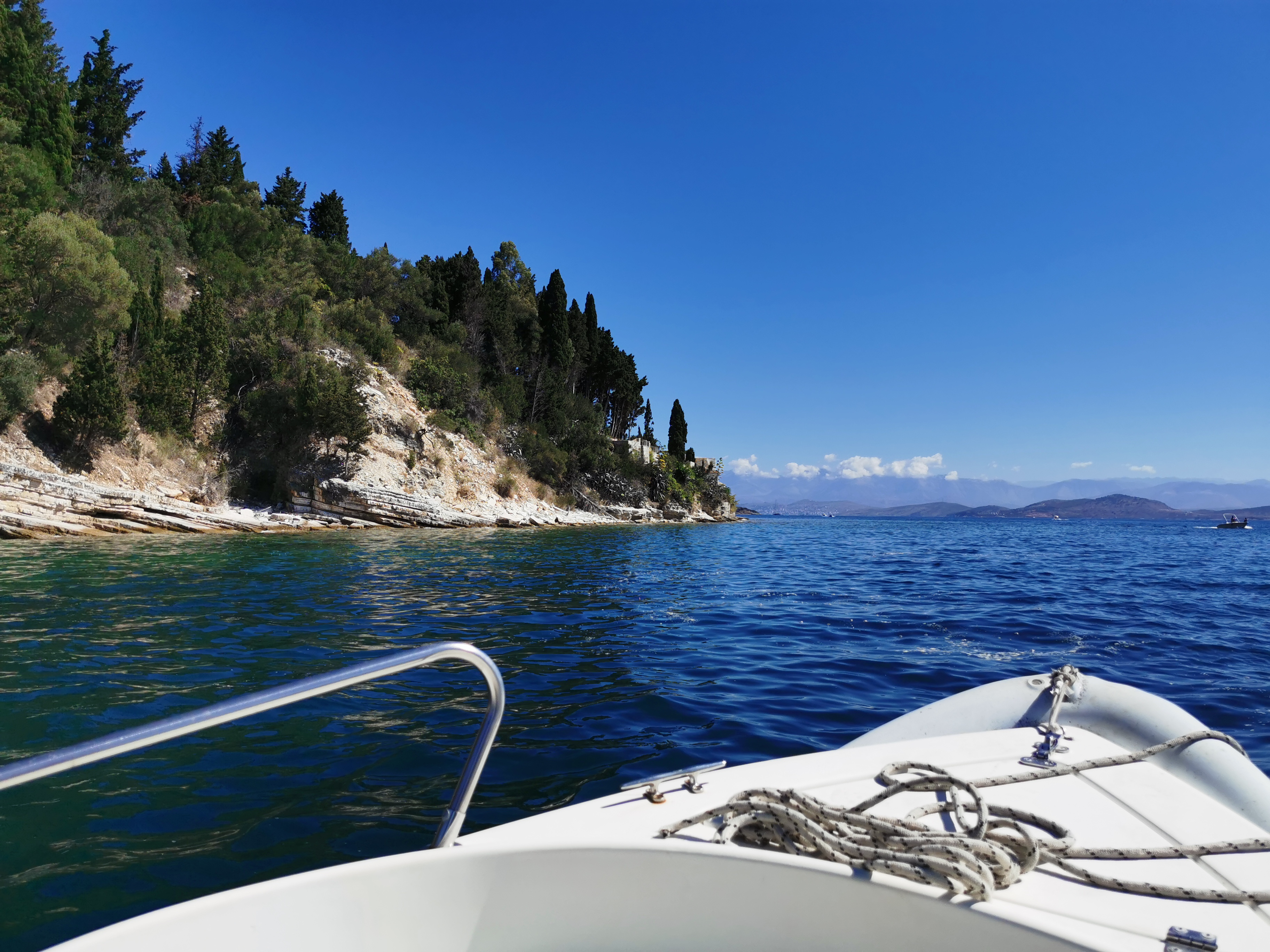 Hiring a boat offers a different view of Corfu's coastline