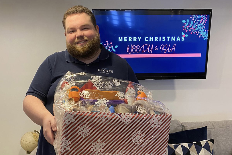 Ryan Sowney with gifts from Arrange My Escape to Isla and Woody