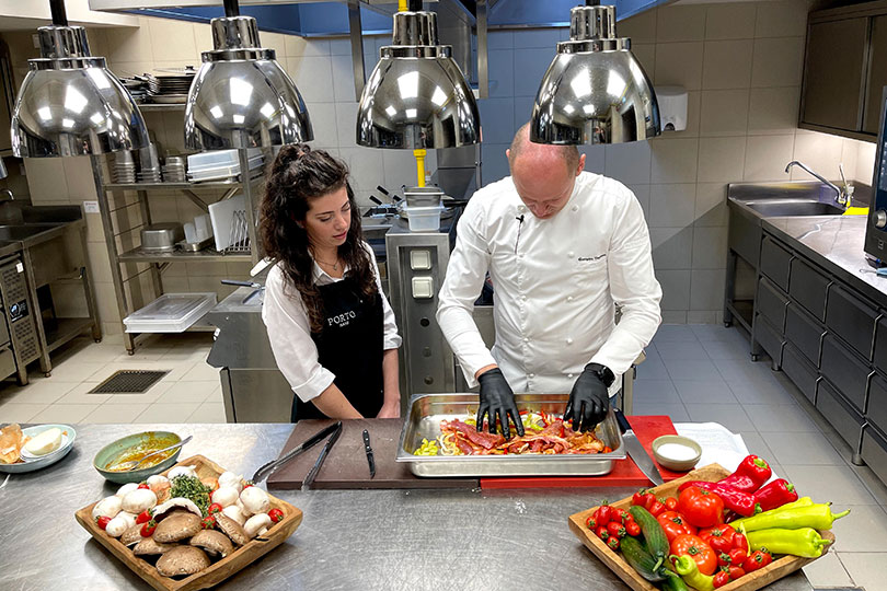 Chef Vagionas shows agents how to prep the pork dish