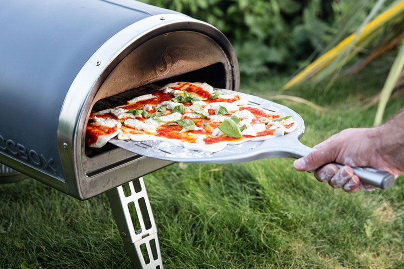 Extras such as a pizza oven can be added for outdoor living
