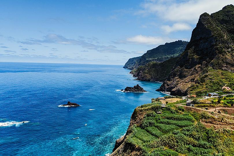 Madeira's beautiful coastline features verdant cliffs and azure waters (Credit: Stephen Lammens/Unsplash)